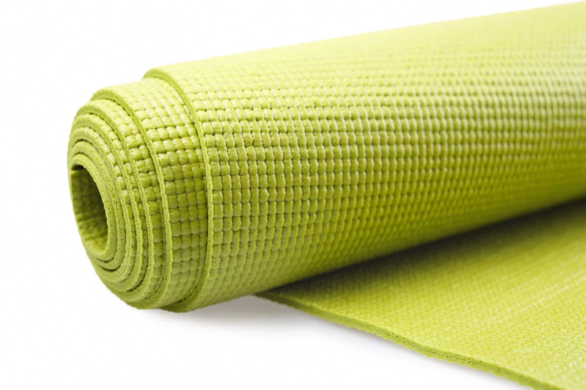 You can recognize a PVC yoga mat by its bumpy surface.